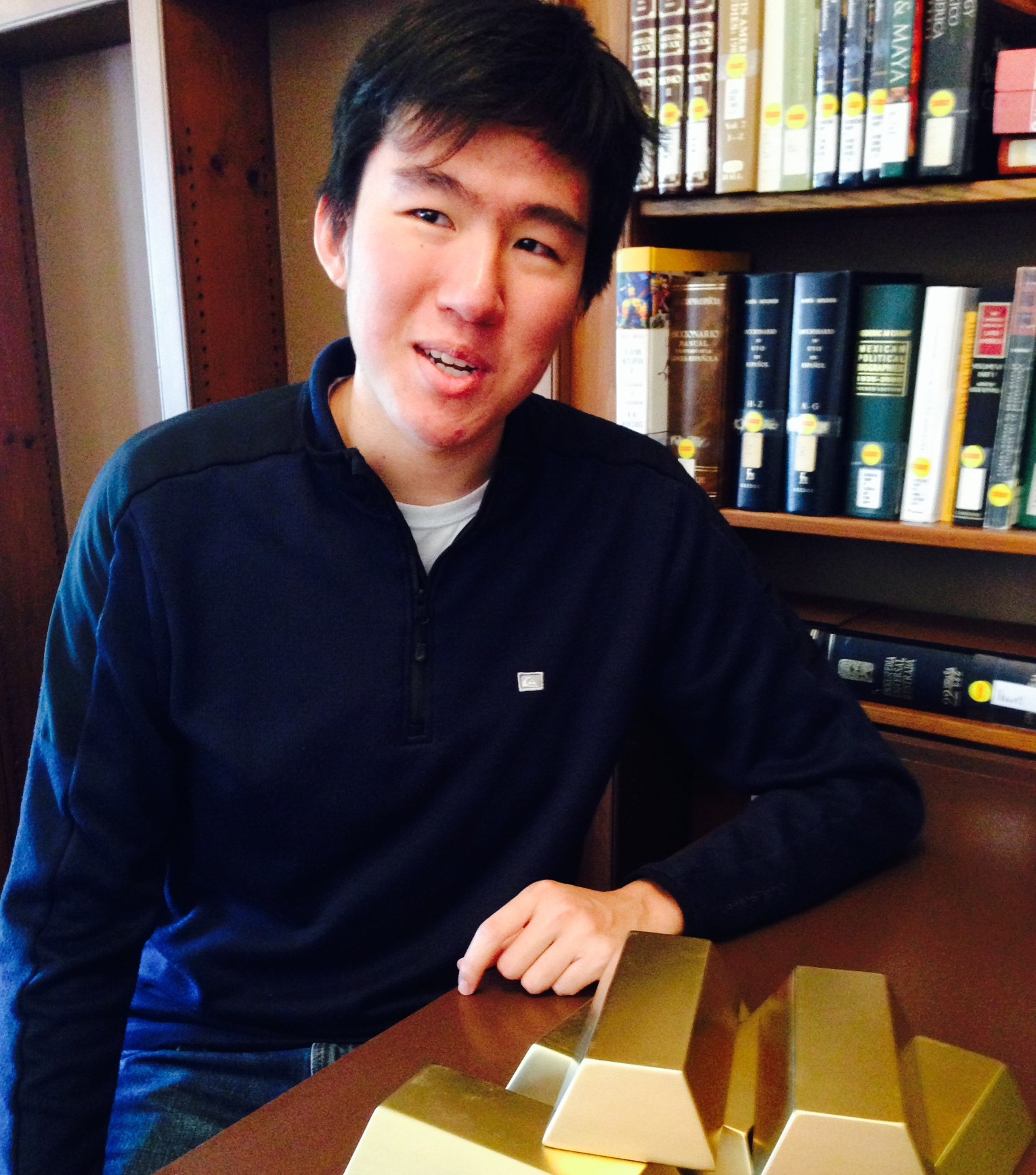 "Brandon Chang with ""gold"" bars from the USC Libraries' Federal Reserve exhibition"