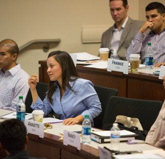 MBV students Annette Leija and Frankie Lugo (back center) learned from classroom guests like General David Petraeus.