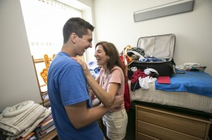 Danyal Brink and his mother, Deniz Dishman, share a laugh while Brink moves in to his USC room. (Photo/David Sprague)