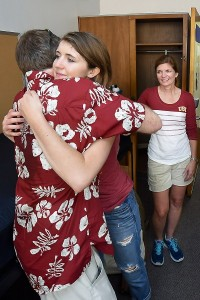 Freshman Maddi Eckert hugs father Jeff Eckert as her mother, Kathy Eckert, looks on. (USC Photo/Gus Ruelas)