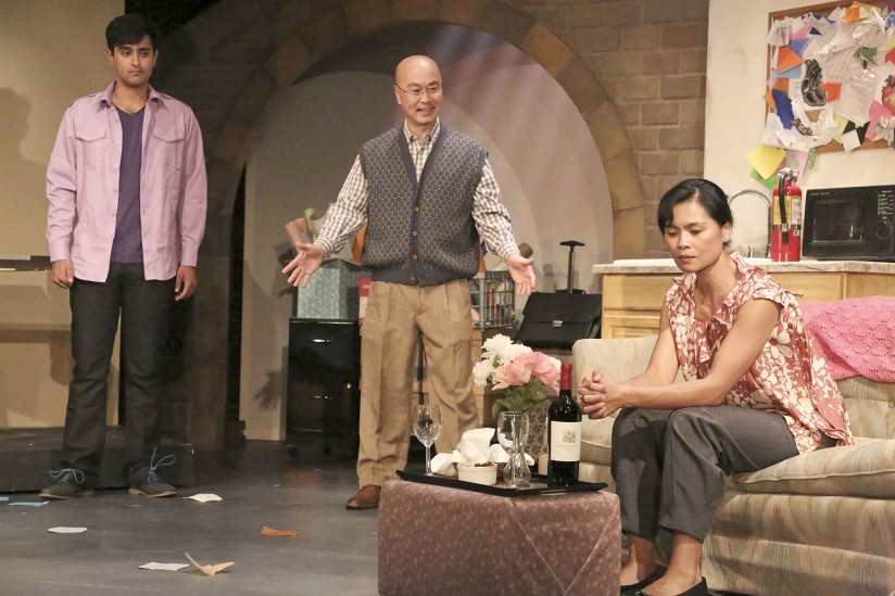 Kapil Talwalkar, left, C.S. Lee and Tess Lina perform in a scene from Animals Out of Paper. (Photo/Michael Lamont/East West Players)