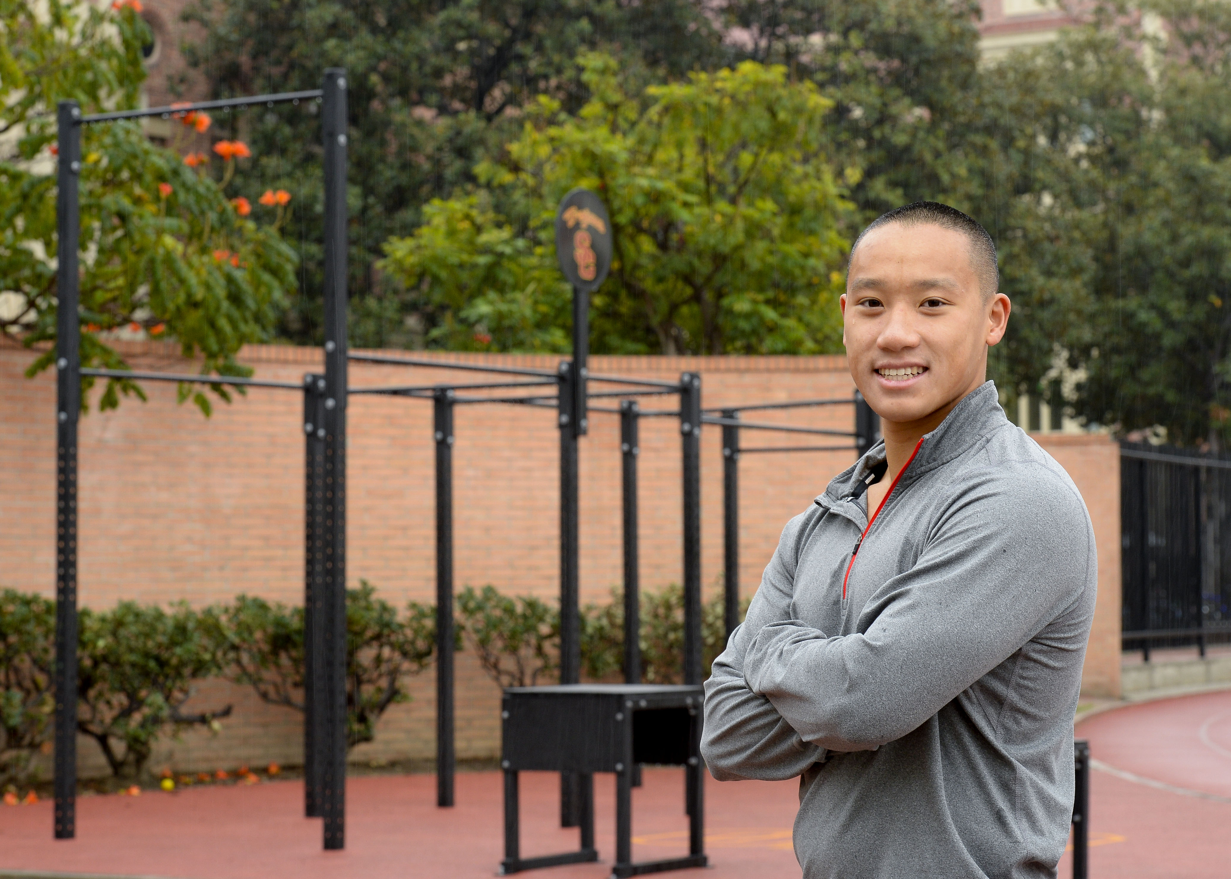 USC Marshall School of Business student Eric Chan spearheaded the new workout area at Cromwell Field. (USC Photo/ Gus Ruelas)