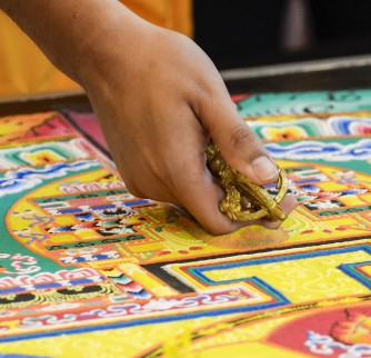 Tibetan monks of the Drepung Loseling Monastery for the Mystical conduct a dissolution ceremony, the dismantling of the sand painting called a Mandala as part of an event by USC Pacific Asia Museum & the University Religious Center on September 18, 2015 at the University Religious Center. The Mandala is a Tibetan Buddhist tradition that involves the creation and destruction of paintings made from colored sand.(USC Photo/Gus Ruelas)