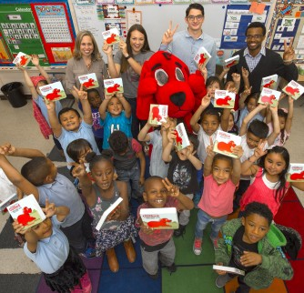 Clifford the Big Red Dog delivers books to Ms. Elizabeth Dominguez's kindergarten class at Vermont Elementary. The books were donated by the USC Greek Councils to support the USC Family of Schools, Monday, May 23, 2016.(USC Photo/Gus Ruelas)